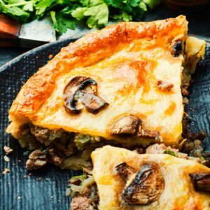 Rabbit Pot Pie Topped with Cheese & Sliced Mushrooms - Critter Cookbook